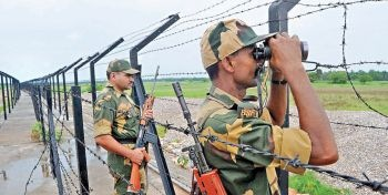 Border Security Force personnel keep vigil at the Masalabari outpost on the Indo-Bangladesh border in Dhubri district of Assam on June 14. There are reasons to believe that some terror cells that plan and execute attacks in India operate from Bangladesh.