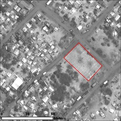 By 6 May 2009, numberous probable internally displaced persons structures are present in this image, along with a graveyard (outlined in red), containing an estimated 195 burials.