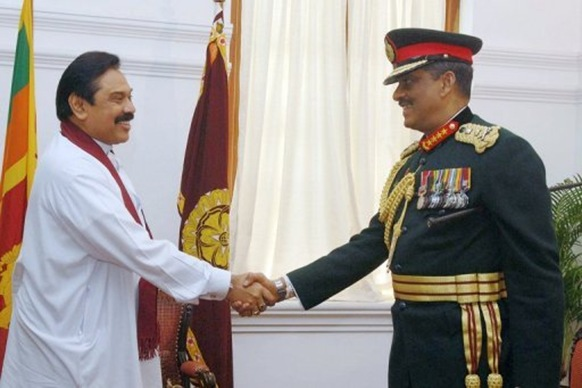 Mahinda Rajapakse (left) and Sarath Fonseka fell out over who should take credit for the victory over the Tamil Tigers