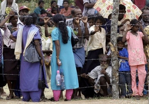 Tamil civilians at the Manik Farm refugee camp