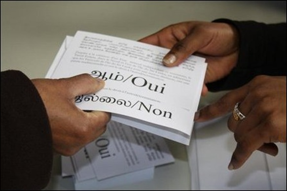 Following the French system of referendum, there were different slips to say 'yes' and 'no'.