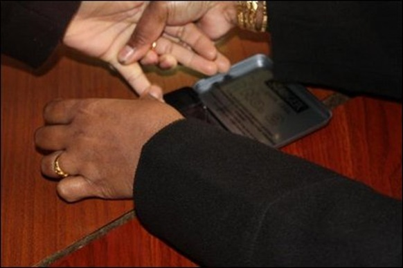 Application of indelible ink to prevent duplication
