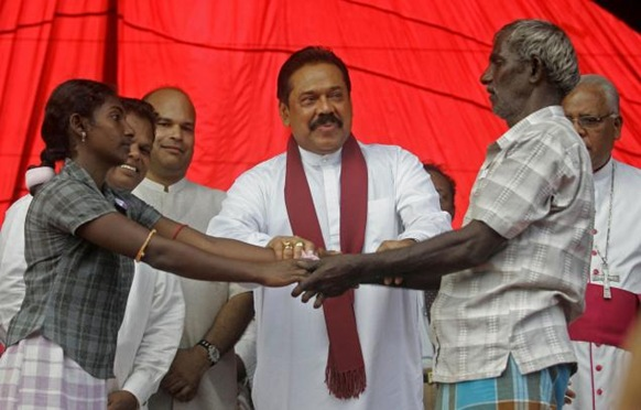 AP Sri Lankan President Mahinda Rajapakse hands over a former child combatant to her parent during a ceremony at Manik Farm in Vavuniya, Sri Lanka on Saturday, Jan. 9, 2010. Photo: AP
