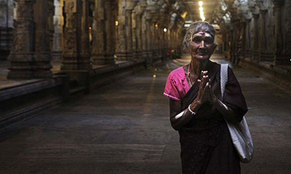 A Tamil woman prays at a temple in Colombo. AP