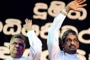 Ranil Wickremesinghe, Sri Lanka's opposition leader, and Sarath Fonseka, the former army chief and defeated presidential candidate, wave to supporters in Colombo last month. Ishara S Kodikara -AFP