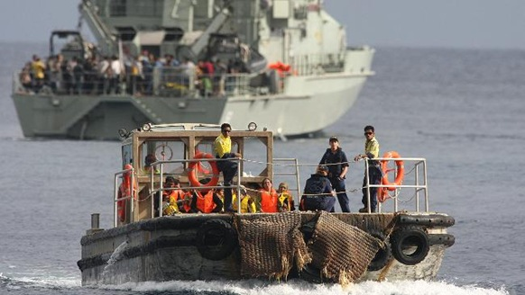 Asylum seekers on a barge from HMAS Wollongong to go to Christmas Island. Picture: Colin Murty  Source: Herald Sun