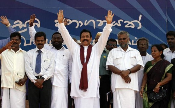 AP Sri Lankan President Mahinda Rajapaksa acknowledges the crowd during a public rally in Jaffna. Photo: AP