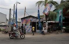 A Sri Lankan motorcyclist rides past an election office of Sri Lankan President Mahinda Rajapaksa's United People's Freedon Alliance's candidate A.H.M. Fowzie in Colombo, Sri Lanka, Wednesday, April 7, 2010. Sri Lanka's parliamentary elections are scheduled for Thursday  AP Photo Eranga Jayawardena