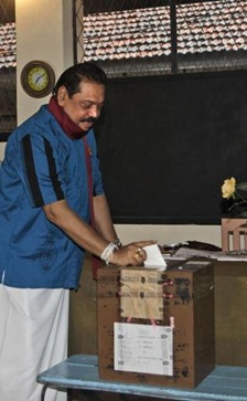 Sri Lankan President Mahinda Rajapaksa casts his vote for parliamentary elections in his home town village Madamulana, 225 km from Colombo on Thursday ap