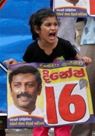 A supporter of Sri Lankan president Mahinda Rajapaksa's United People's Freedom Alliance shouts slogans AP Photo