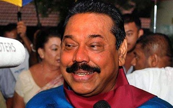 Sri Lankan president Mahinda Rajapaksa speaking to the media after casting his vote for the parliamentary elections at Madamulana in Hambanthota Photo EPA