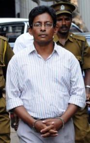 Sri Lanka President Mahinda Rajapakse granted a pardon to journalist J.S. Tissainayagam, pictured