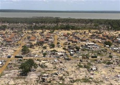 An aerial view of the former battlefront is seen from the helicopter carrying U.N. Secretary-General Ban Ki-moon during his visit to the refugee camp known as Manik Farm, on the outskirts of the northern Sri Lankan town of Vavuniya May 23, 2009. Credit: Reuters Louis Charbonneau