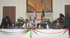 Agreements being signed between Sri Lankan and Indian delegations under presence of Mahinda Rajapaksa and Manmohan Singh