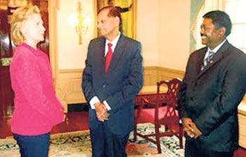 U.S. Secretary of State Hillary Clinton in conversation with External Affairs Minister G.L. Peiris and Ambassador Jaliya Wickramasuriya at the State Department in Washington