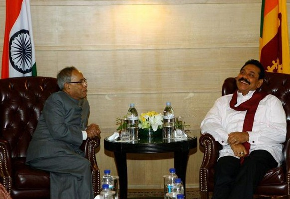 PTI Union Finance Minister Pranab Mukherjee and Sri Lankan President Mahinda Rajapaksa during a meeting in New Delhi on Tuesday. pti