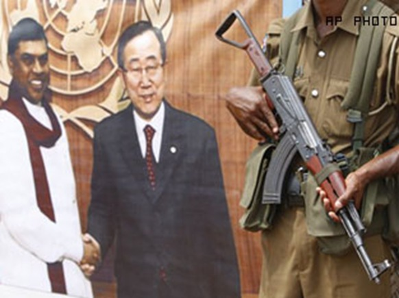 Sri Lanka's banner of UN Ban, with gun, Vavuniya camps