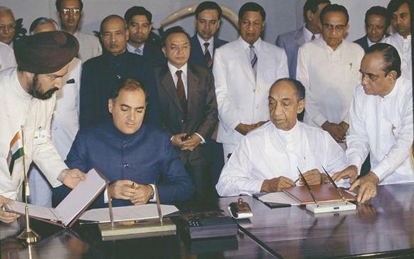 The Hindu Prime Minister Rajiv Gandhi and Sri Lankan President J.R. Jayewardene sign the historic Indo-Sri Lanka accord in Colombo on July 29, 1987. File photo