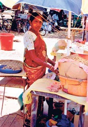 Trade hope: A woman sells peanuts in Murikandi