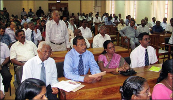 Professor S.K. Sitrampalam speaking to the Indian Foreign Secretary at the gathering of civil society representatives in the Public Library of Jaffna
