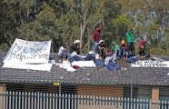 Asylum-seekers have protested from the roof of a Sydney immigration centre for a second day