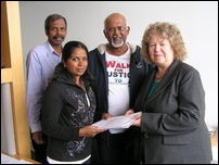 Mrs Thevaki Kumar hands over an appeal to Ms. Jean Lambert MEP, the chair of the South Asia delegation in the European Parliament in Strasbourg.