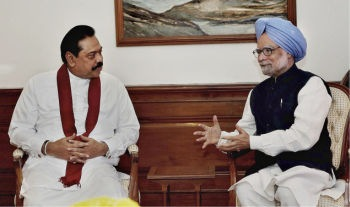 Cordial talks:Prime Minister Manmohan Singh makes a point to Sri Lankan President Mahinda Rajapaksa at a meeting in New Delhi on Friday. Colombo said it would talk to a broad spectrum of stakeholders to build a consensus.