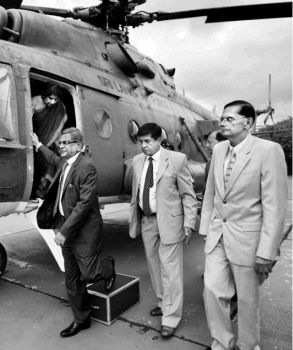 External Affairs Minister S.M. Krishna and his Sri Lankan counterpart, Gamini Lakshman Peiris (right), arrive on a special helicopter at a defence base in Colombo on Thursday. Foreign Secretary Nirupama Rao is seen alighting from the chopper.