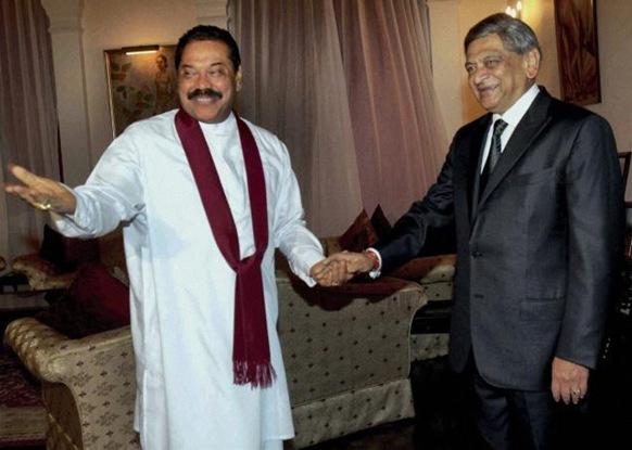 PTI Sri Lankan President Mahinda Rajapaksa welcomes External Affairs Minister S. M. Krishna, in Colombo, on Friday.