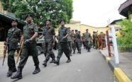 Sri Lankan soldiers patrol outside Colombo's main jail following a drug raid