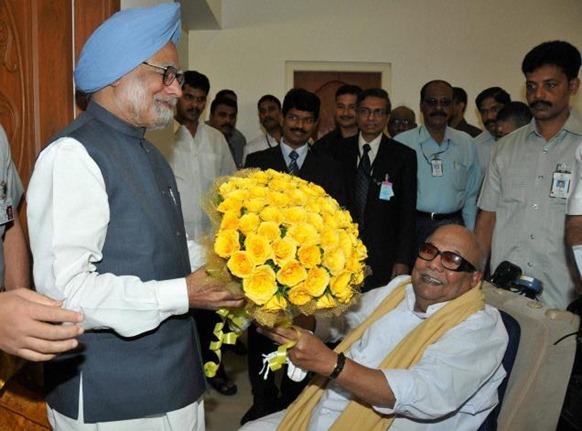 PTI Tamil Nadu Chief Minister M Karunanidhi presents a bouquet to Prime Minister Manmohan Singh during a meeting at Raj Bhavan in Chennai. A PTI file photo.