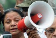 The wife of Sri Lanka's jailed ex-military chief Sarath Fonseka, Anoma Fonseka (R) addresses supporters