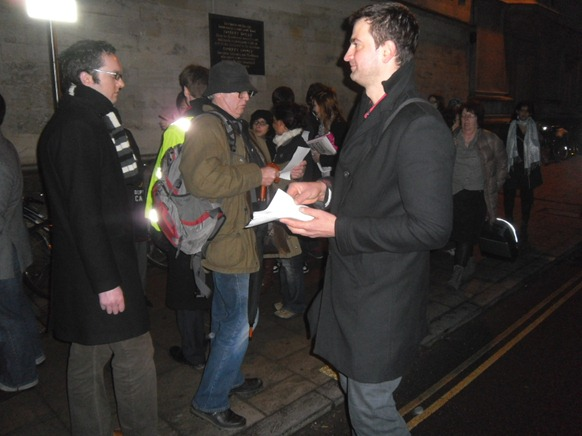 Act Now campaigners handing out leaflets to attendants in the Queue.