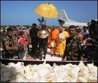 Occupying Sinhala military receiving the sapling and the monks came in a special flight to Jaffna