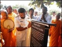A military official unveiling the Sinhala version of the 'Rajapaksa inscription'