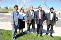 Dr Rajakulendran, Michelle Rowland, Laurie Ferguson, John Murphy, and Prof. Selvanathan