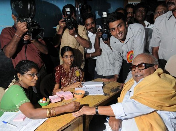 The Hindu A polling official places an indelible ink mark on the finger of Chief Minister M. Karunanidhi in Chennai on Wednesday. Photo: M. Vedhan