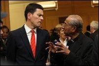 Former UK foreign Secretary David Miliband [left] with GTF's Father S. J. Emmanuel