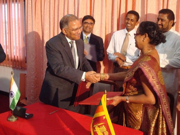 The Hindu Indian High Commissioner to Sri Lanka Ashok K. Kantha and Sri Lankan Ports and Highways Secretary Sujatha Kure exchange documents signing an MoU on the development of the KKS port in the northern province in Colombo on Wednesday. Photo: R.K. Radhakrishnan