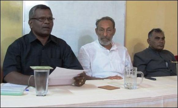 Vasudeva Nanayakara [middle] addressing press in Jaffna