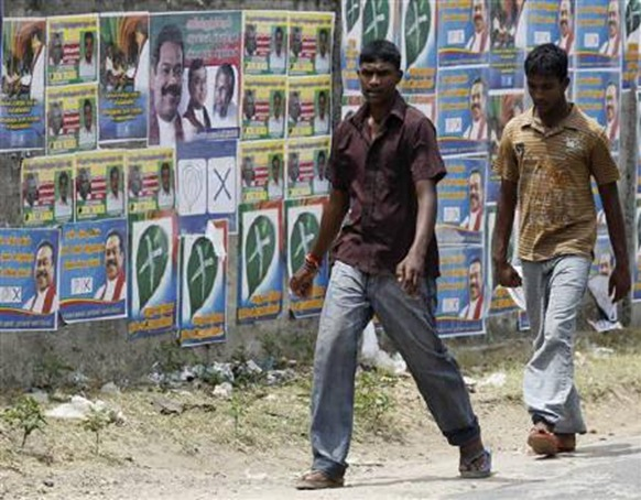 Two boys walk past local government election campaign posters in Jaffna, about 304 km (189 miles) north of Colombo, July 22, 2011. Credit: Reuters Dinuka Liyanawatte