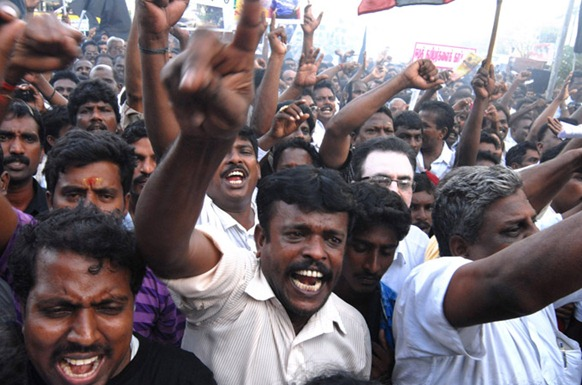 Tamil protesters in India have called for Sri Lankan President Mahinda Rajapaksa to be hanged following the final offensive in the island's war - but demonstrators have been labelled as terrorists by authorities [EPA]
