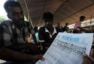Former Tamil Tiger rebels read Uthayan newspaper in Jaffna in 2008 (AFP, Lakruwan Wanniarachchi)
