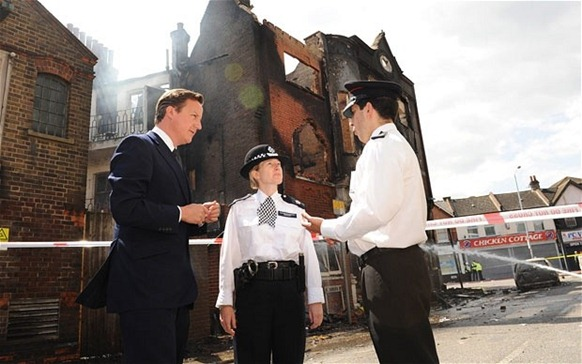 Prime Minister Cameron in Croydon, speaking to police commanders before visiting shops on London road