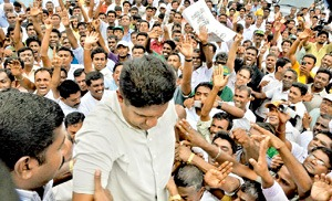 Sajith Premadasa co-deputy leader of UNP surrounded by the crowd at the UNP rally held at the Town Hall in Colombo on Thursday Pic by Gemunu Wellage