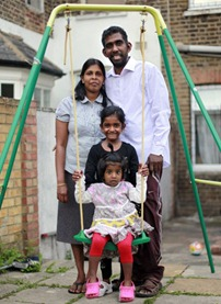 Close family: shopkeeper Shiva Kandiah has the support of his neighbours as well as wife Baskary and daughters Shivaanthy, six, and Dibika, two
