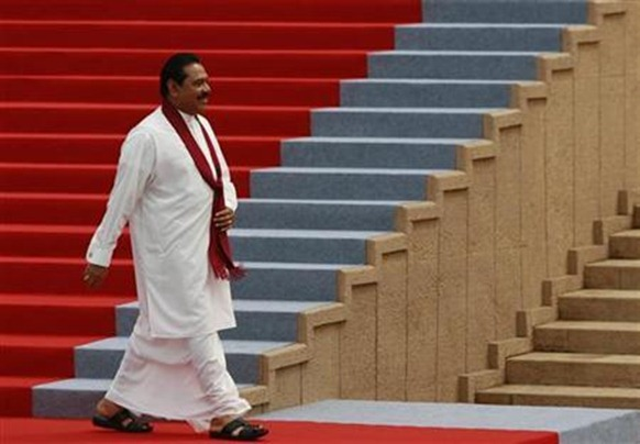 Sri Lankan President Mahinda Rajapaksa smiles as he walks the red carpet at the Presidential Secretariat building after taking the oath of office for a second term in Colombo, November 19, 2010. Credit:Reuters Andrew Caballero-Reynolds