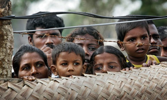 Internally displaced Tamils at a camp Sri Lanka, where those forcibly removed from the UK face risk of maltreatment, say charities. Photograph: Eranga Jayawardena AP
