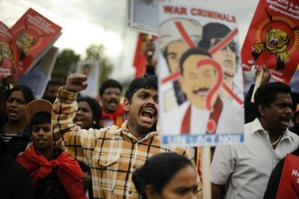 A Tamil activist reacts during a demonstration at the UN's European headquarters in Geneva (AFP, Fabrice Coffrini)