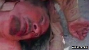 Al-Jazeera TV broadcast footage it says showed Col Gaddafi's body